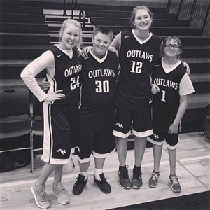 Members of the Sisters High School Project Unify basketball team pose after a game