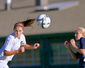 Nika Chick with a header against Sutherland in the girls' first win. photo by Jerry Baldock