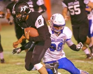 Outlaw Christopher Luz had almost 300 yards on offense against Sutherlin. Photo by: Jerry Baldock