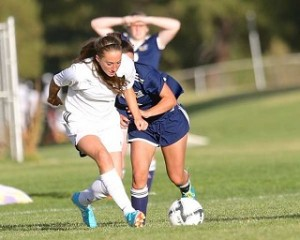 Brooke Robillard moves the ball up the field vs. Cottage Grove. photo by Jerry Baldock