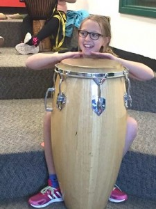 Sisters Elementary School fourth-grader Althea Trask plays a djembe. photo by Erin Borla