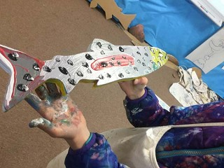 Sisters students create fish art for mural